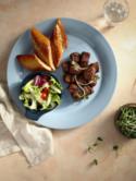 Bò nướng Nha Trang - món ăn độc đáo với sự kết hợp giữa cách chế biến của miền biển và tinh hoa ẩm thực đương đại.